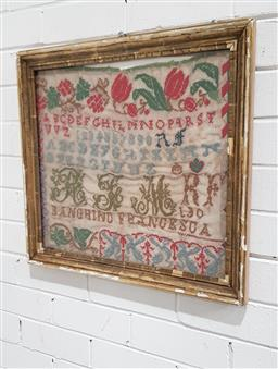Sale 9126 - Lot 1025 - Late 19th Century Childs Sampler, with tulips, alphabet and numbers, in an aged gilt frame (51 x 57cm)