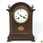 Sale 8649 - Lot 44 - Edwardian Sheraton Style 8 Day Mantle Clock with Ebony and Satinwood and Brass Finials (with Keys)