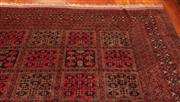 Sale 9020H - Lot 6 - A Large geometric hand woven Persian rug in red tones 385 x 300cm