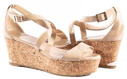 Sale 9132 - Lot 351 - A PAIR OF JIMMY CHOO PORTIA 70 WEDGE SANDALS; nude patent leather with cross over straps and cork heels, size 41, comes with dust ba...