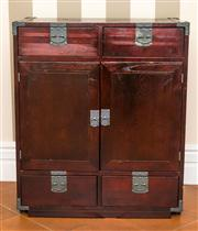 Sale 8222 - Lot 68 - An Oriental style four drawer, two door cupboard, with metal hardware, H 90, W 77, D 42cm