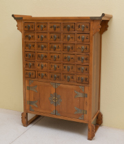 Sale 8677B - Lot 629 - A Chinese timber medicine cabinet comprising of 30 small drawers over two cupboard doors H 84 w 69 D 25cm