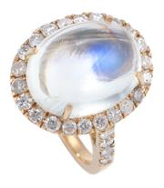 Sale 8937 - Lot 442 - A MOONSTONE AND DIAMOND COCKTAIL RING; centring an approx. 10ct cabochon moonstone (14.4 x 11.8mm) to surround and shoulders set wit...