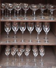 Sale 9055H - Lot 97 - A quantity of quality drinking glasses comprising ten small wine goblets, nine champagne coupes, ten white wine glasses, and twelve...