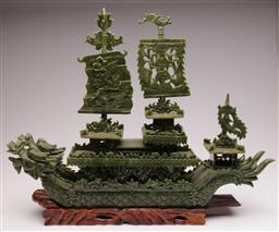Sale 9138 - Lot 160 - Ornate Chinese Greenstone Ship with Three Detachable Sails together with a Hardwood Stand (H46cm W58cm D13cm)