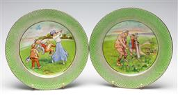 Sale 9246 - Lot 34 - A pair of Stoke on Trent golf themed cabinet plates (Dia:26cm)