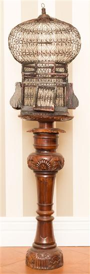 Sale 8222 - Lot 82 - An elaborate timber and wire birdcage on plinth, birdcage H 74cm Film Provenance of plinth; Australia, 2008