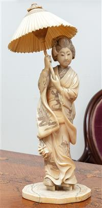 Sale 8963H - Lot 46 - A large Meiji carved ivory okimono figure of a Bijin with parasol (parasol restored, restored cracks to base and lacking signature p...