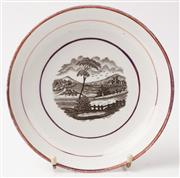 Sale 9048A - Lot 61 - A Sunderland Lustre black transfer printed dish with country scene, diameter 20cm