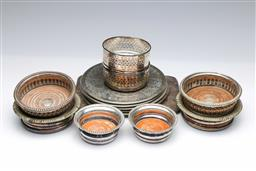 Sale 9098 - Lot 262 - Group of silver plated bottle coasters and placemats incl. Strachan