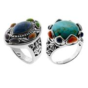 Sale 8065 - Lot 307 - TWO SILVER RINGS; set with coloured ornamentals.