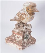 Sale 8376A - Lot 27 - A large plaster Kookaburra perched on a tree stump, significant paint loss visible, small chip under beak, ht 35cm