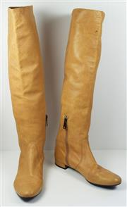 Sale 8460F - Lot 40 - A pair of Prada caramel leather knee high boots, hardly worn, size 38.5