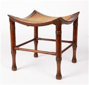 Sale 9048A - Lot 14 - A late Victorian walnut  Thebes  stool with woven seat attributed to Liberty & Co.
