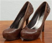 Sale 9066H - Lot 95 - A pair of Guess by Marciano stiletto platforms in brown suede and leather, Size 9M