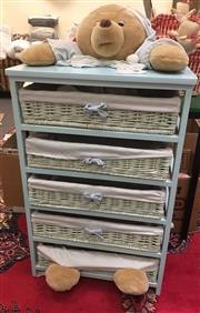 Sale 8310A - Lot 428 - A pale blue chest of five wicker drawers with plush toy to top