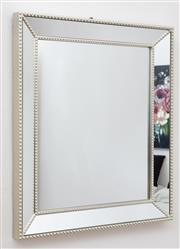 Sale 9070H - Lot 21 - A contemporary mirror of rectangular form with mirrored frame and beading 42cm x 52cm