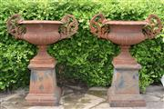 Sale 9087H - Lot 201 - A pair of cast iron urns on plinths, with aged rust patina. 96cm height, 78cm width.