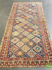 Sale 8500 - Lot 1067 - Antique West Persian Wool Carpet, with colourful off-set diamonds, the main border with arrows (275 x 135cm - some faults)