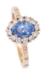 Sale 9044J - Lot 58 - A CEYLON SAPPHIRE AND DIAMOND CLUSTER RING; centring an untreated blue oval cut sapphire of 1.37ct surrounded by 12 round brilliant...