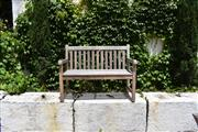 Sale 9087H - Lot 231 - A teak bench with weathered patina. 1.2m width