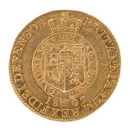 Sale 9130E - Lot 34 - A George III 22 carat gold half guinea proclamation coin dated 1802, weight 4.17g