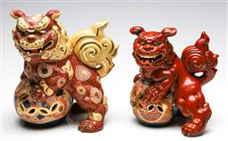 Sale 9246 - Lot 35 - A graduating pair of Chinese handpainted ceramic foo lions (H:23cm to 27.5cm)