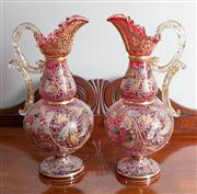 Sale 8470H - Lot 26 - A pair of possibly Moser ruby gilt and enamelled ewers with arabesques of oak leaves, fruit and bees, H 36cm