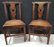 Sale 8956 - Lot 1073 - Set of Seven Late Georgian Oak Provincial Dining Chairs with Carved Splats with pierced hearts includes one armchair (H:92.5 x W:45...