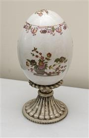 Sale 8205 - Lot 53 - A porcelain egg on a silver plated stand, total H 26cm