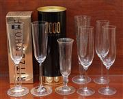 Sale 9055H - Lot 100 - A small group of quality champagne flutes including Riedel and Ritzenhoff and millennium motif.