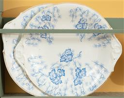 Sale 9120H - Lot 221 - A pair of Royal Worcester twin handled cake plates with blue leaf design and gilt rims, Width 27cm