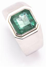 Sale 8937 - Lot 424 - A GENTS PLATINUM SOLITAIRE EMERALD RING; rub set with an approx. 3.50ct square emerald cut emerald, size W1/2. wt. 9.37g.