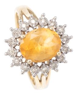 Sale 9124 - Lot 313 - A 9CT GOLD CITRINE AND DIAMOND CLUSTER RING; centring an oval cut citrine of approx. 1.47ct to surround of 16 illusion set single cu...