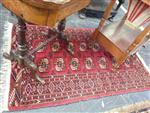 Sale 7919A - Lot 1749 - Small Tekke Turkomen Carpet with 2 Rows of Guls in Red Tones