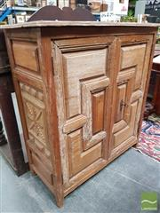 Sale 8485 - Lot 1041 - Continental Rustic Pine Cabinet, incorporating early elements, with two panelled doors having a forged iron lock (Key In Office)