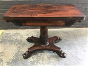 Sale 9031 - Lot 1049 - William IV Rosewood Fold-Over Card Table, the top with rounded corners, on a gun barrel pedestal with tulip collar, on a quadraform...