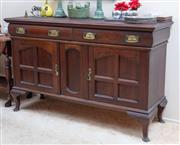 Sale 9071H - Lot 42 - An Arts and Crafts oak sideboard, the two drawers above two panelled doors raised on cabriole legs, Height 95cm x Width 152cm x Dept...