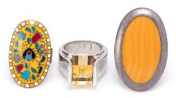 Sale 9164J - Lot 537 - THREE LARGE SILVER STONE SET AND ENAMEL RINGS; one set with a square cut citrine, size N, width 11mm, a large oval ornamental stone,...