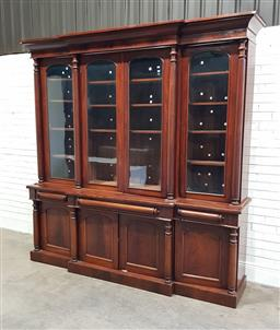 Sale 9179 - Lot 1008 - Good Mid-19th Century Mahogany Breakfront Bookcase, with four arched glass panel doors, flanked by turned columns, above three friez...