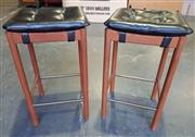 Sale 9002 - Lot 1074 - Pair of Parker Bar Stools with Clip-On Black Leather Cushions (H: 70 x L: 40 x W: 35cm)