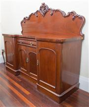 Sale 8470H - Lot 54 - A late C19th cedar breakfront sideboard with carved back, a drawer and four arched panel doors, some veneer missing, H 158 x D 59cm