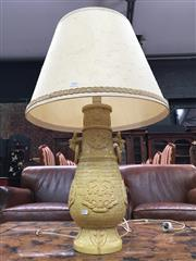 Sale 8882 - Lot 1052 - Italian Yellow Pottery Lamp Base, of Chinese archaic design with mask heads & shade