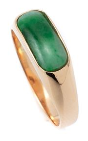 Sale 9066A - Lot 3 - AN 18CT GOLD JADE RING; rub set with a 12 x 5mm long oval cabochon variegated green jade, size O, wt. 3.44g.