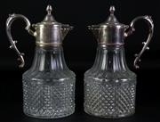 Sale 8931B - Lot 661 - silver plated pair of hobnail cut decanters (height - 26cm)