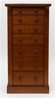 Sale 8980J - Lot 57 - An English antique central locking Wellington chest C: 1880. The oak and pine chest with 7 graduated knob handled drawers with a cen...