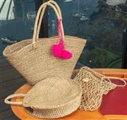 Sale 9044H - Lot 44 - A collection of three woven beach bags including an example by Little Marcel, Largest Width 58cm