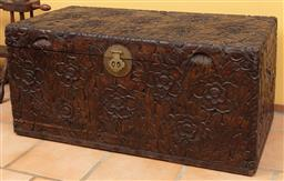 Sale 9120H - Lot 226 - An oriental camphorwood trunk profusely carved with floral decorations, Height 47cm x Width 100cm x Depth 50cm