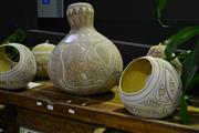Sale 8058 - Lot 1008 - Assorted  Nigerian Decorative Gourds incl. Baskets and Vases