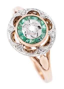 Sale 9169 - Lot 339 - A 9CT ROSE GOLD EMERALD AND DIAMOND RING; round top centring a round brilliant cut diamond within 12 trapezoid cut emerald surround...